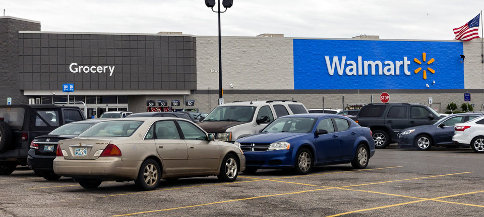 Photo - Cars in the parking lot at the Walmart location in Yukon, Okla. on Monday, April 13, 2020.  [Chris Landsberger/The Oklahoman]