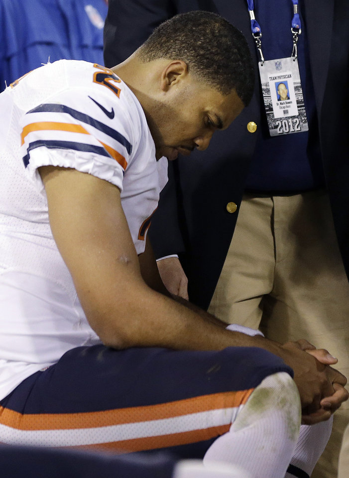 Chicago Bears quarterback Jason Campbell (2) sits on the bench as he is looked over by a team physician during the second half of an NFL football game against the San Francisco 49ers in San Francisco, Monday, Nov. 19, 2012. (AP Photo/Marcio Jose Sanchez)