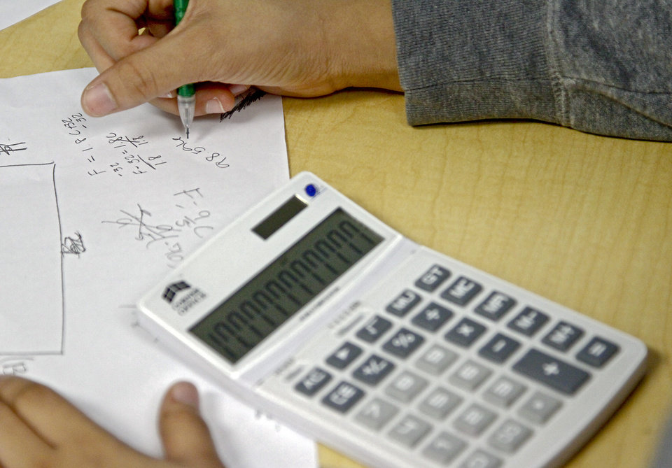A student uses a calculator to work a math problem in class at John Marshall High School on Friday, March 30, 2012, in Oklahoma City, Okla. Photo by Chris Landsberger, The Oklahoman