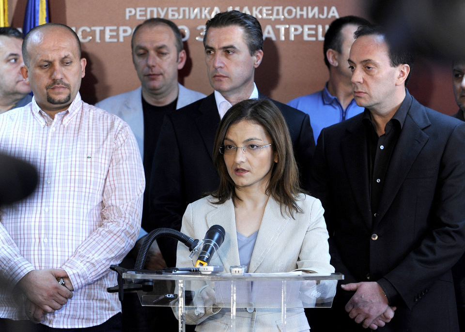 Macedonian Interior Minister Gordana Jankuloska, center, talks to the media surrounded by her associates during a news conference in the capital Skopje, Macedonia, Tuesday, May 1, 2012. Macedonian authorities say they have arrested 20 people, all radical Islamists, in the murder of five Macedonian fishermen last month that fueled ethnic tensions in this tiny Balkan country. They have been charged with terrorism. (AP Photo/Boris Grdanoski)