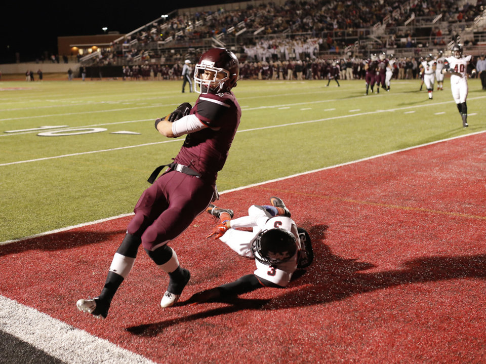Photo - Westmoore' Cassius Hill dives for Jenks Dylan Harding as he scores a touchdown during the 6A high school playoff game between Westmoore and Jenks at Yukon High School Friday November 29, 2013. Photo by Doug Hoke, The Oklahoman