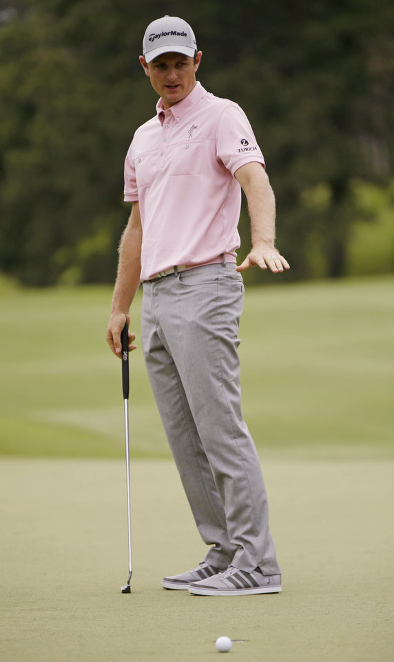 Photo - Justin Rose of England, gestures after his ball misses the 7th hole cup during the final round of The Players championship golf tournament at TPC Sawgrass, Sunday, May 11, 2014 in Ponte Vedra Beach, Fla. (AP Photo/Gerald Herbert)