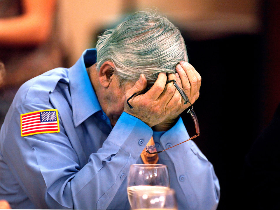 Photo - Don Walters rests his head in hands after finishing his meal. He and his wife, Carol, of Oklahoma City, dined with hundreds of other guests at the 30th Edmond Community Thanksgiving Dinner in the George Nigh Student Center on the campus of University of Central Oklahoma, Thursday,  Nov. 24, 2011.  Photo by Jim Beckel, The Oklahoman