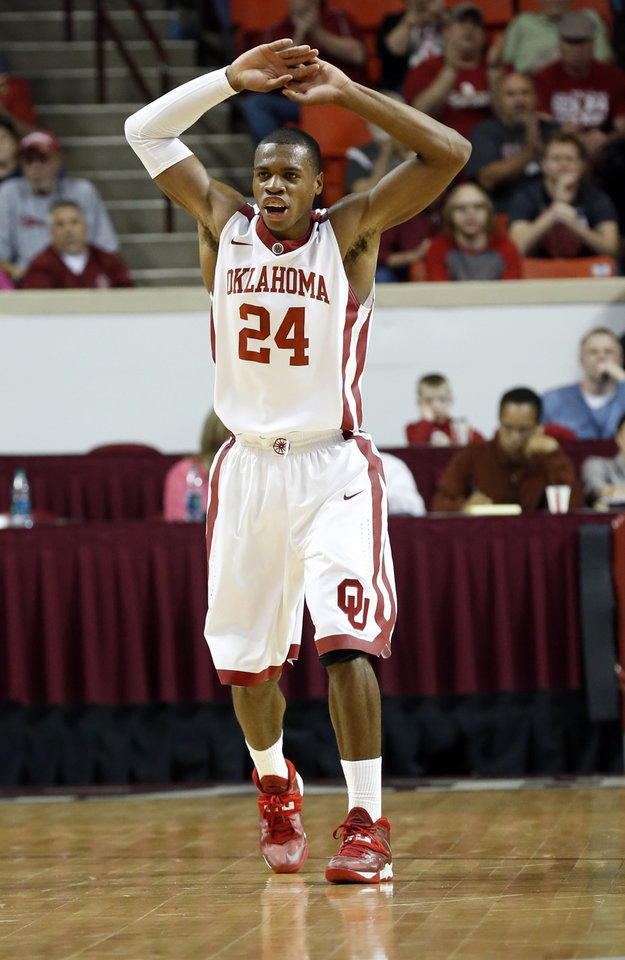 Photo - Oklahoma Sooner's Buddy Hield (24) leads the cheers after a shot in the first half as the University of Oklahoma Sooner (OU) men play the Kansas State Wildcats (KS) in NCAA, college basketball at The Lloyd Noble Center on Saturday, Feb. 22, 2014 in Norman, Okla. Photo by Steve Sisney, The Oklahoman