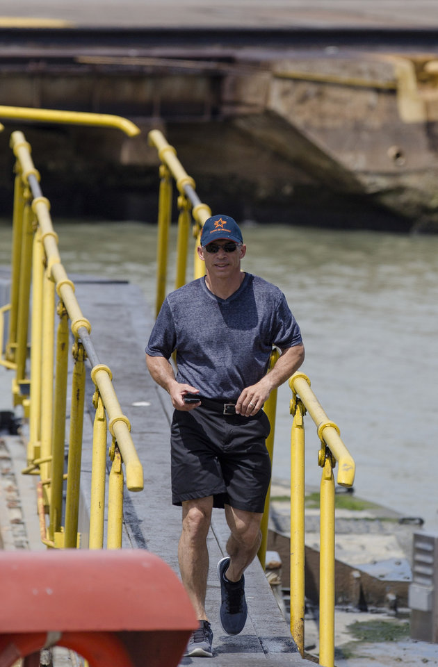 Photo - Joe Girardi manager of New York Yankees walks across the the Miraflores Locks at the Panama Canal in Panama City, Friday, March 14, 2014. The New York Yankees and the Miami Marlins will play on March 15-16, in the