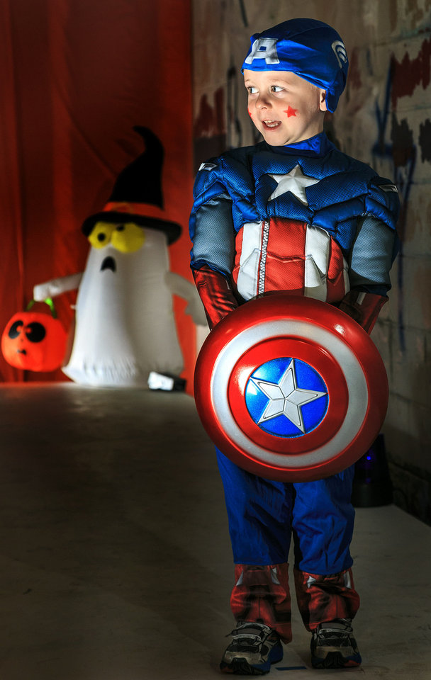 Photo - Christopher wears a Captain America costume from Party Galaxy. The costume comes with padded jumpsuit, hat and shield. Photo by Chris Landsberger, The Oklahoman  CHRIS LANDSBERGER