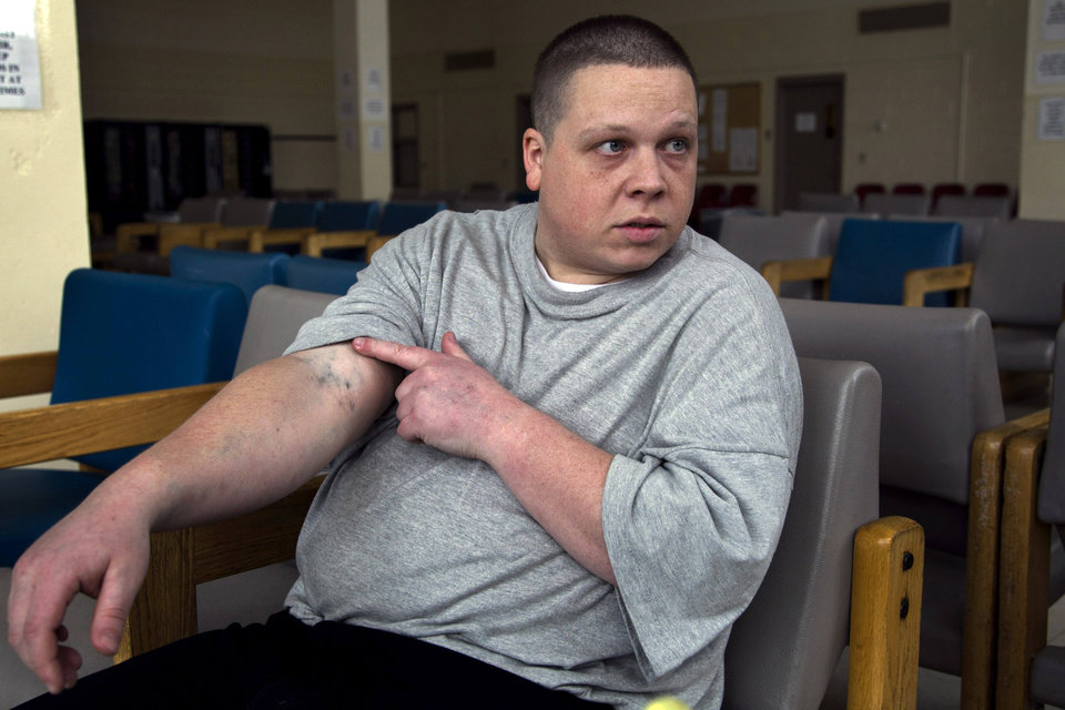 Photo -   In this Thursday, April 12, 2012 photo, inmate Steve Wohlen displays heroin needle tracks in his arm during an Associated Press interview in a state prison, in Bridgewater, Mass. Wohlen was saved from a life-threatening heroin overdose in 2010 by his mother when she applied two quick sprays of Narcan, a drug that blocks opioid receptors in the brain to reverse overdoses of opiates. The drug, widely sold under its generic name, naloxone, counteracts the effects of heroin, OxyContin and other powerful painkillers and has been routinely used by ambulance crews and emergency rooms in the U.S. and other countries for decades. But in the past few years, public health officials across the nation have been distributing it free to addicts and their loved ones, as well as to some police and firefighters. Wohlen is serving a 5- to 7-year sentence for an armed robbery he committed to support his heroin habit. (AP Photo/Steven Senne)