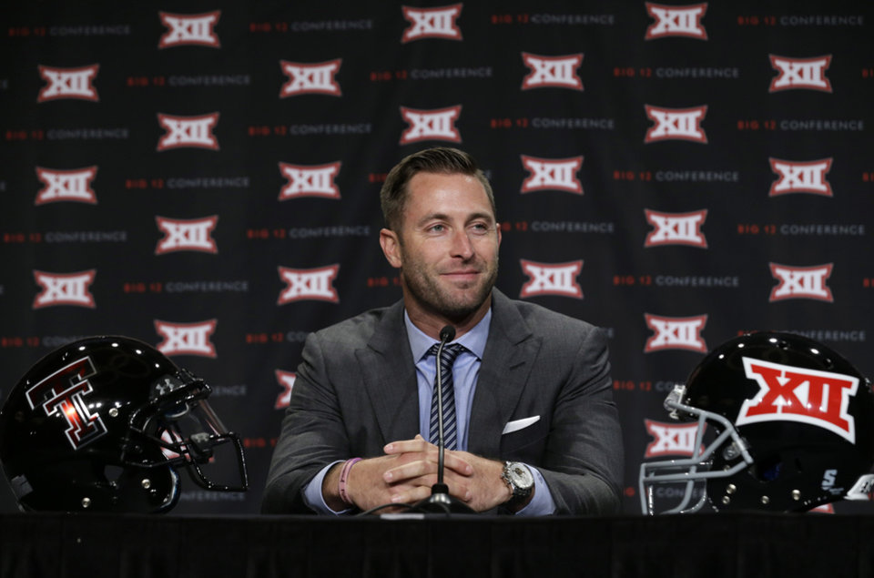 Photo - Texas Tech head coach Kliff Kingsbury smiles as he listens to a reporters' question during the NCAA college Big 12 Conference football media days in  Dallas, Monday, July 21, 2014. (AP Photo/LM Otero)
