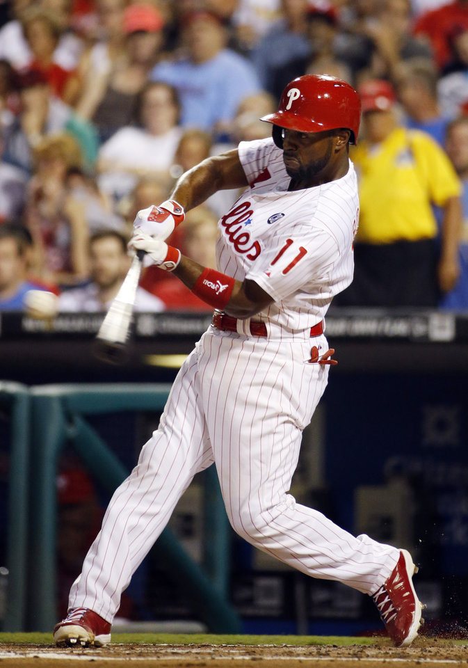 Photo - Philadelphia Phillies' Jimmy Rollins hits a home run off Washington Nationals starting pitcher Doug Fister during the first inning of a baseball game, Wednesday, Aug. 27, 2014, in Philadelphia. (AP Photo/Matt Slocum)