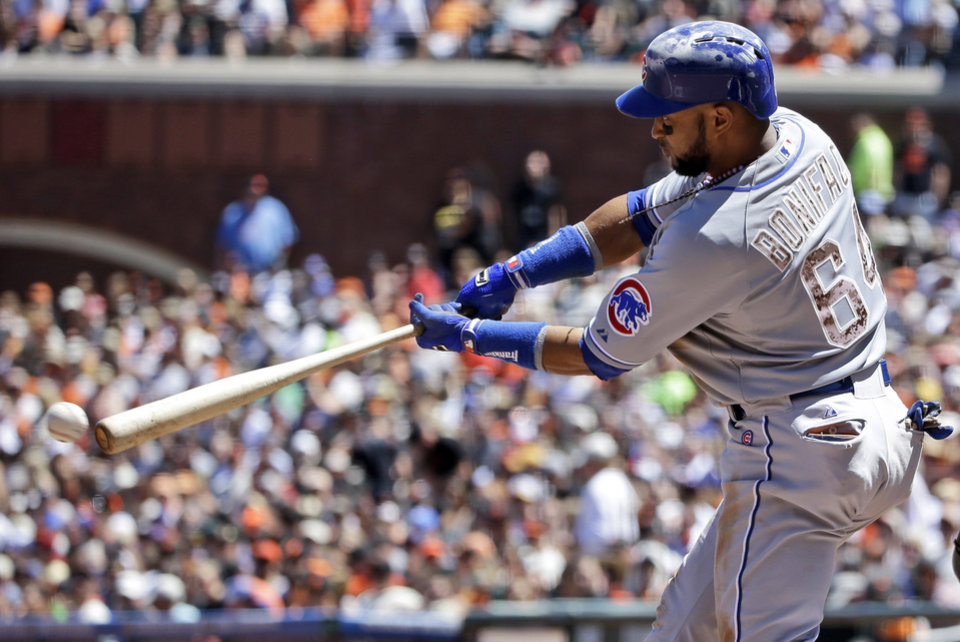 Photo - Chicago Cubs' Emilio Bonifacio drives in a run with a triple against the San Francisco Giants during the fifth inning of a baseball game on Monday, May 26, 2014, in San Francisco. (AP Photo/Marcio Jose Sanchez)