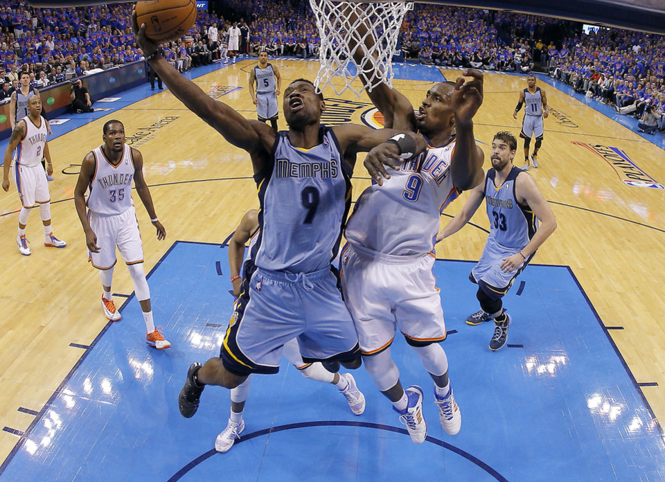 Photo - Oklahoma City's Serge Ibaka (9) defends against Memphis' Tony Allen (9) during Game 7 in the first round of the NBA playoffs between the Oklahoma City Thunder and the Memphis Grizzlies at Chesapeake Energy Arena in Oklahoma City, Saturday, May 3, 2014. Photo by Sarah Phipps, The Oklahoman