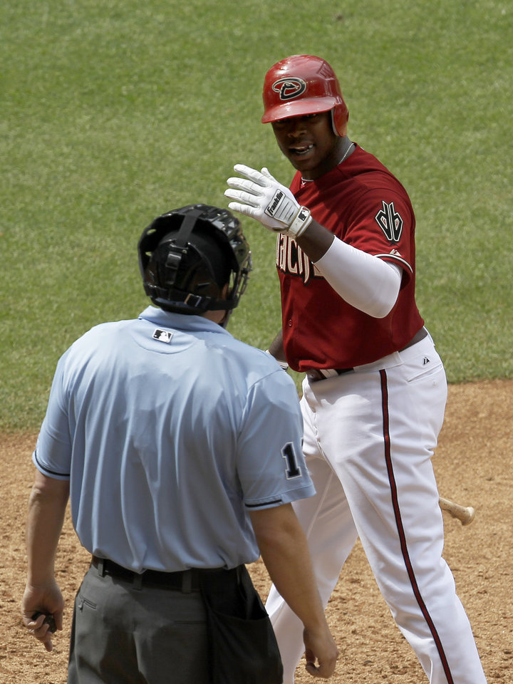 Photo -   Arizona Diamondbacks' Justin Upton argues with umpire Mike DiMuro after being called out on strikes during the sixth inning in an MLB baseball game against the San Francisco Giants Sunday, April 8, 2012, in Phoenix.(AP Photo/Ross D. Franklin)