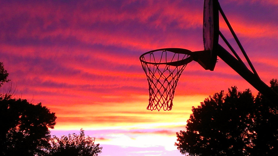 In the spirit of Thunder basketball heating up...a basketball goal with an Oklahoma sunset as a backdrop. Photo by Susan Bible