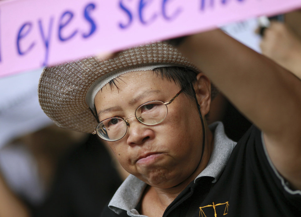 Photo - A Thai woman joins a protest against the coup outside a shopping complex in Bangkok, Thailand Saturday, May 24, 2014. Thailand's coup leaders said Saturday they will keep former Prime Minister Yingluck Shinawatra, Cabinet members and anti-government protest leaders detained for up to a week to give them