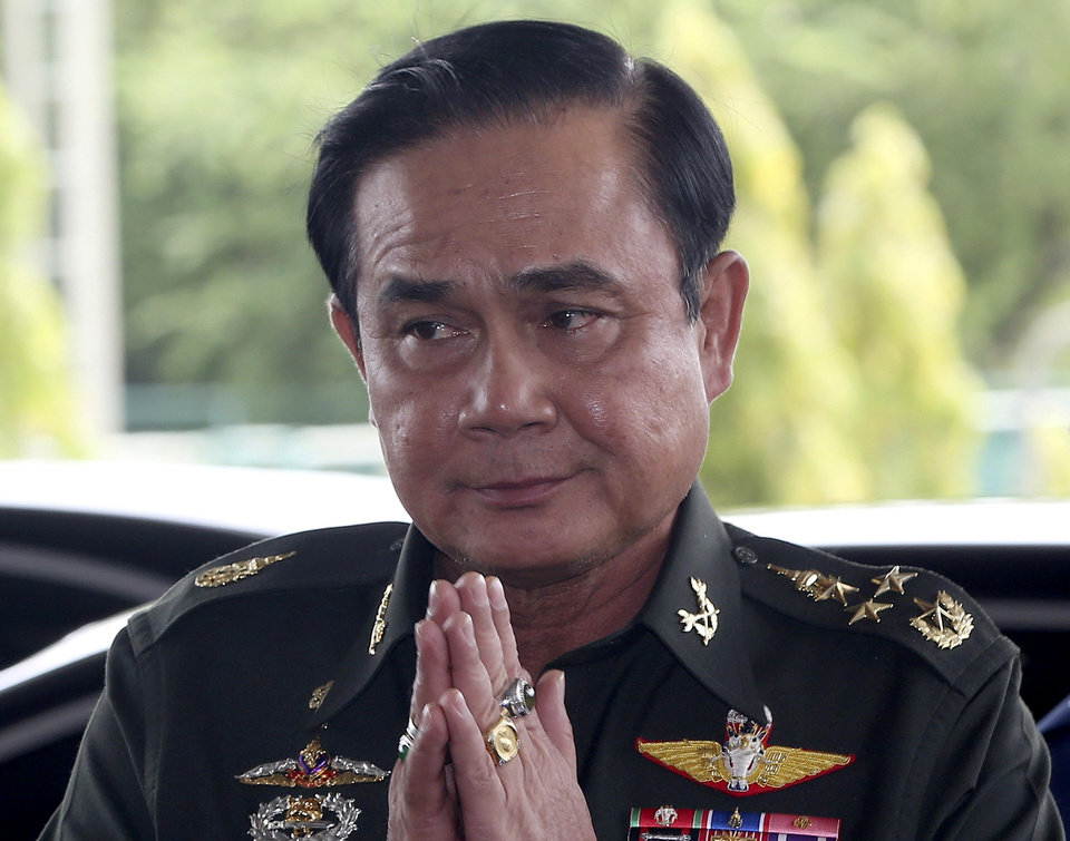 Photo - FILE - In this Tuesday, May 20, 2014 file photo, Thai Army Chief Gen. Prayuth Chan-Ocha greets back his junior upon his arrival at army club for a meeting with high ranking officials after declaring martial law in Bangkok, Thailand.  Thailand's coup leader said the country's monarchy has officially endorsed him to run the country after the armed forces seized power last week. Gen. Prayuth Chan-ocha said he received the endorsement Monday, May 26,  formalizing his status as head of government at the army headquarters in Bangkok (AP Photo/Apichart Weerawong, File)