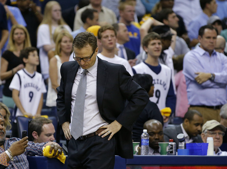 Photo - Oklahoma City coach Scott Brooks walks towards the bench during Game 3 in the first round of the NBA playoffs between the Oklahoma City Thunder and the Memphis Grizzlies at FedExForum in Memphis, Tenn., Thursday, April 24, 2014. Memphis won 98-95. Photo by Bryan Terry, The Oklahoman