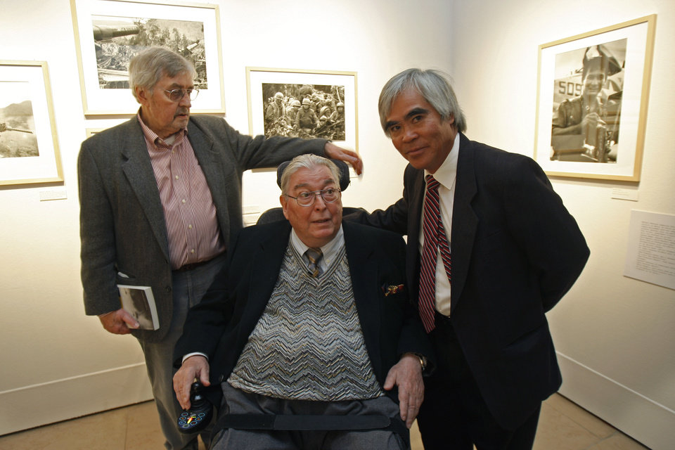 Photo -   FILE - In this Tuesday Feb. 8, 2011 file photo, Richard Pyle, former Associated Press bureau chief in Saigon, left, Horst Faas, former AP chief photographer and photo editor in Saigon, center, and Nick Ut, former AP photographer in Saigon, right, pose at the 'Henri Huet, Vietnam' exhibition at the MEP (Maison Europeene de la Photographie) in Paris. Faas, a prize-winning combat photographer who carved out new standards for covering war with a camera and became one of the world's legendary photojournalists in nearly half a century with The Associated Press, Thursday May 10, 2012. He was 79. (AP Photo/Michel Euler, File)