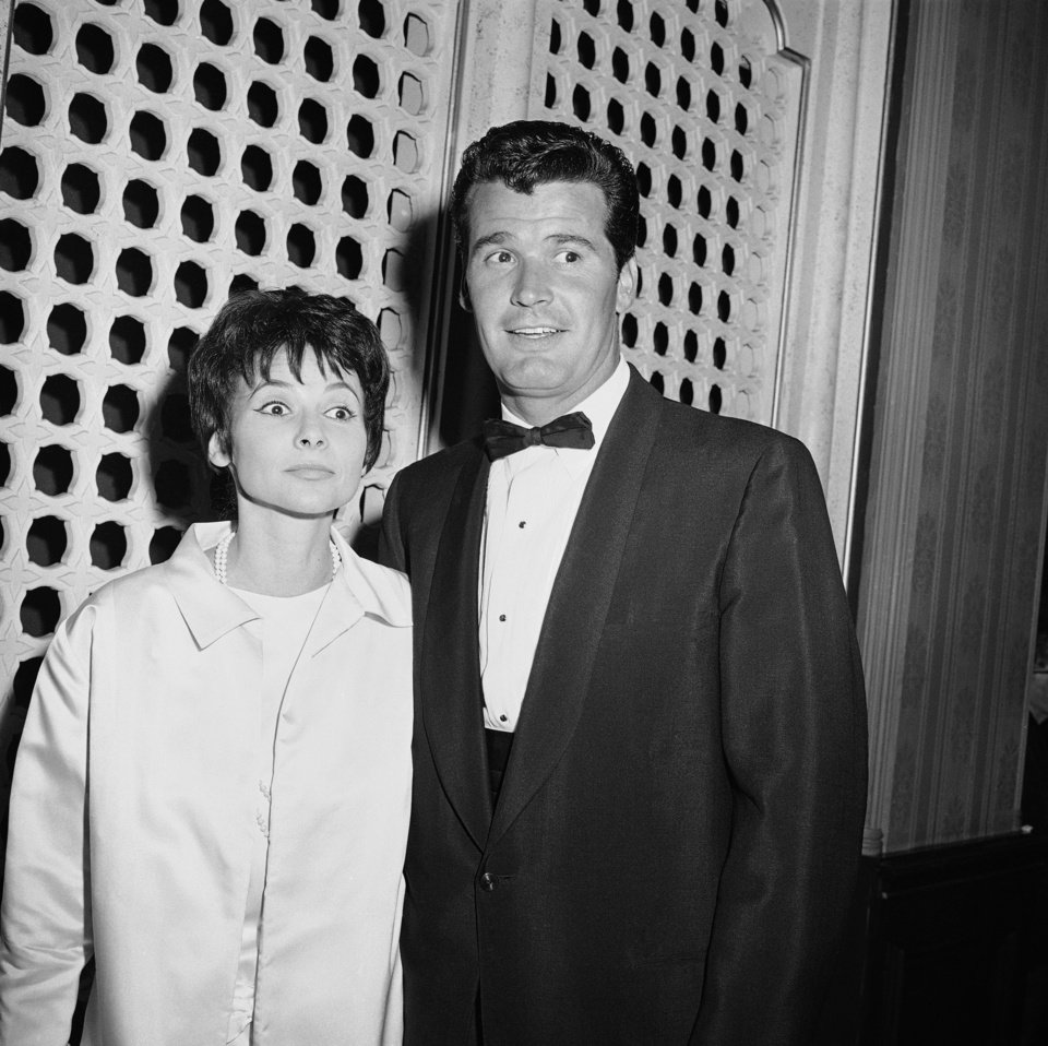 "Photo - FILE - Jim Garner of the TV program ?Maverick? arrives with his wife Lois Clarke at the Emmy Awards, in this April 15, 1958 file photo taken in Hollywood, Los Angeles, Calif. Actor James Garner, wisecracking star of TV's ""Maverick"" who went on to a long career on both small and big screen, died Saturday July 19, 2014 according to Los angeles police. He was 86. (AP Photo/File)"