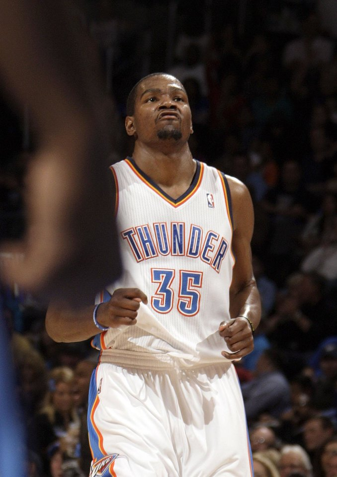 Photo - Oklahoma City's Kevin Durant (35) celeb rates a Thunder basket during the NBA basketball game between the Oklahoma City Thunder and the Denver Nuggets at the Chesapeake Energy Arena, Sunday, Feb. 19, 2012. Photo by Sarah Phipps, The Oklahoman