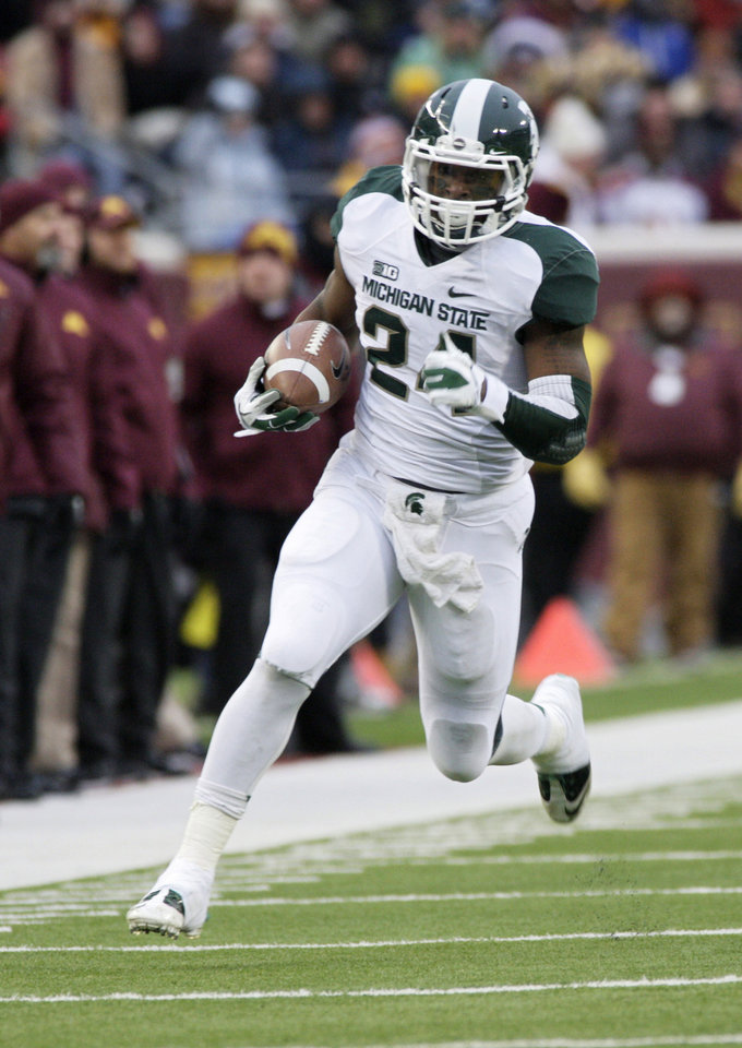 Photo -   Michigan State running back Le'Veon Bell rushes during the first half of an NCAA football game against Minnesota, Saturday, Nov. 24, 2012, in Minneapolis. Bell had 266 yards on 35 carries as Michigan State won 26-10. (AP Photo/Paul Battaglia)