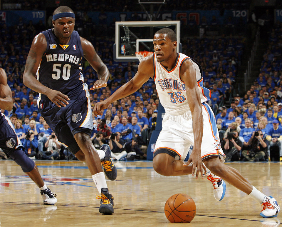Photo - Oklahoma City's Kevin Durant (35) drives the ball past Zach Randolph (50) of Memphis in the first half during game one of the Western Conference semifinals between the Memphis Grizzlies and the Oklahoma City Thunder in the NBA basketball playoffs at Oklahoma City Arena in Oklahoma City, Sunday, May 1, 2011. Photo by Nate Billings, The Oklahoman