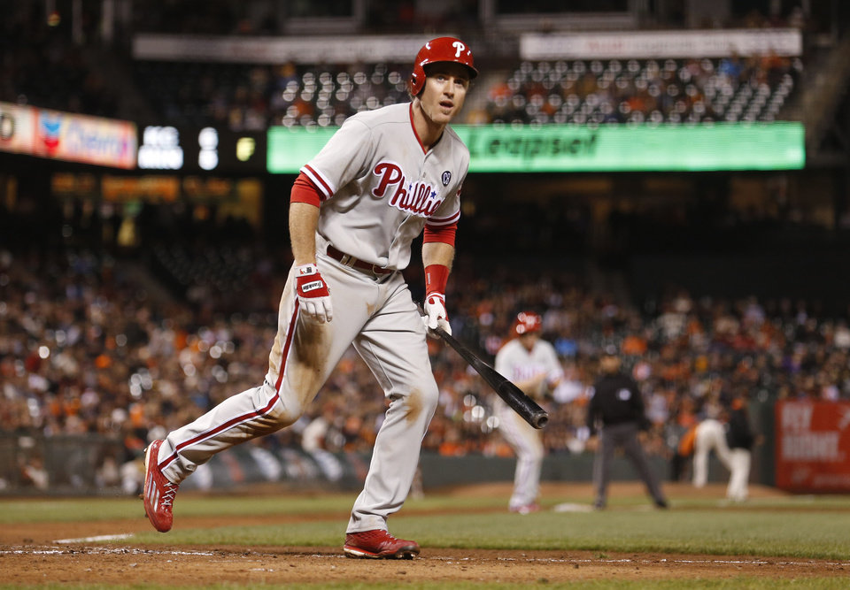 Photo - Philadelphia Phillies' Chase Utley takes his base after San Francisco Giants pitcher Javier Lopez hit Utley with a pitch, forcing a run scored as the bases were loaded during the tenth inning of a baseball game, Friday, Aug. 15, 2014, in San Francisco. (AP Photo/Beck Diefenbach)