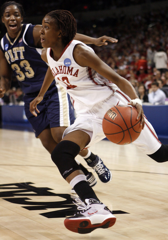 Photo - Danielle Robinson dribble past Xenia Stewart in the first half of the NCAA women's basketball tournament game between the University of Oklahoma and Pittsburgh at the Ford Center in Oklahoma City, Okla. on Sunday, March 29, 2009. 