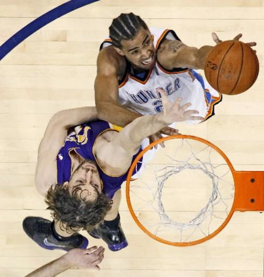 Oklahoma City's Thabo Sefolosha shoots a basket past the Lakers' Pau Gasol during the NBA basketball game between the Los Angeles Lakers and the Oklahoma City  Thunder at the Ford Center,Tuesday, Feb. 24, 2009. PHOTO BY BRYAN TERRY