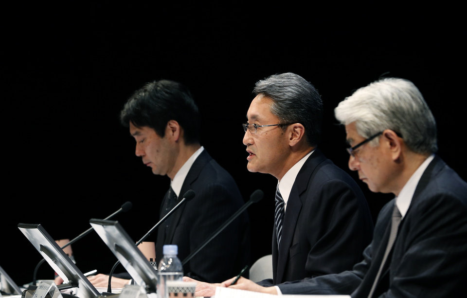 Photo - Sony Corp. President and CEO Kazuo Hirai, center, speaks during a press conference at the Sony headquarters in Tokyo Thursday, Feb. 6, 2014.  Sony is in talks to sell its troubled personal computer business and Thursday lowered its earnings forecast for the business year ending March to a 110 billion yen loss ($1.1 million).The company also said it's cutting its global workforce by about 3 percent or 5,000 people by the end of March 2015 as it restructures its PC, television and other businesses. (AP Photo/Shizuo Kambayashi)