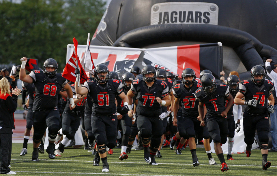 The Westmoore football team takes the field before a high school football game between Westmoore and Norman North in Moore, Okla., Thursday, September 13, 2012. Photo by Bryan Terry, The Oklahoman