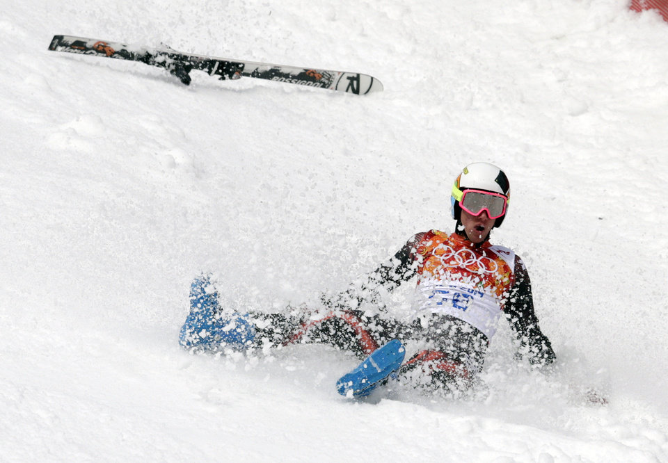 Photo - Spain's Alex Puente Tasias slides down the course after crashing during  the first run of the men's giant slalom the Sochi 2014 Winter Olympics, Wednesday, Feb. 19, 2014, in Krasnaya Polyana, Russia. (AP Photo/Charles Krupa)