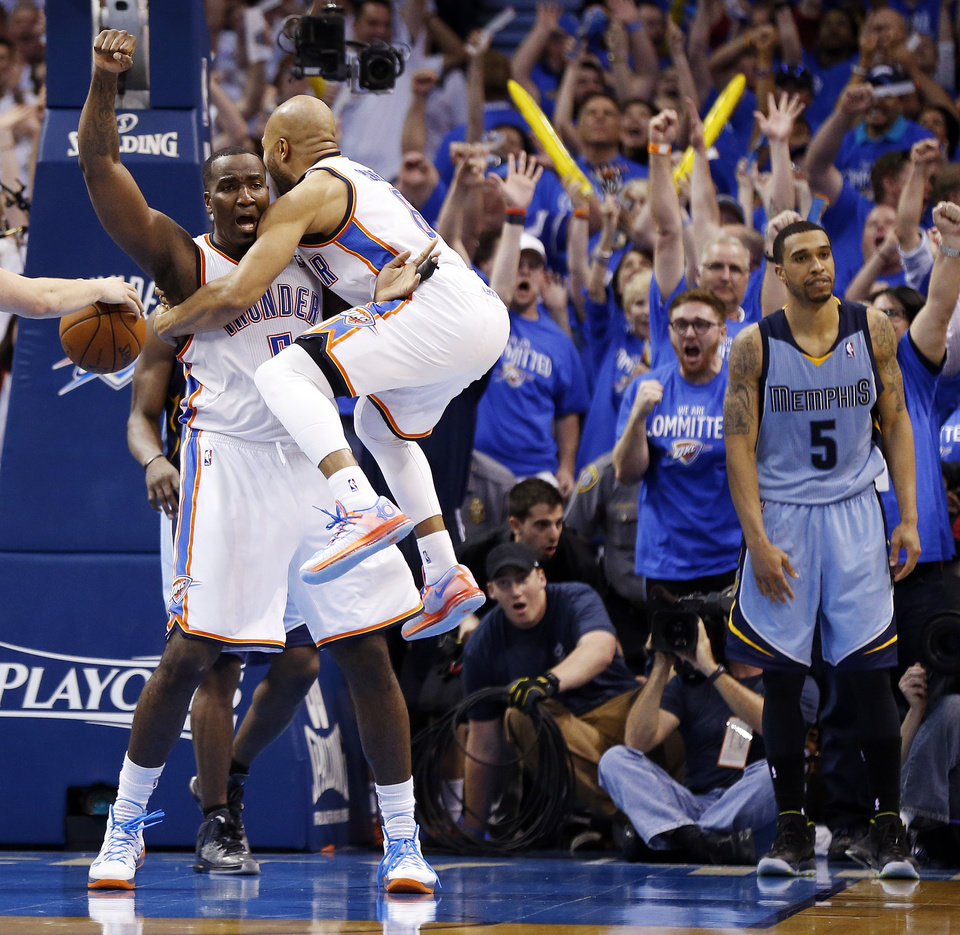 Photo - Oklahoma City's Derek Fisher (6) leaps into the arms of Kendrick Perkins (5) near Memphis' Courtney Lee (5) after Perkins made a basket to send Game 2 to overtime in the first round of the NBA playoffs between the Oklahoma City Thunder and the Memphis Grizzlies at Chesapeake Energy Arena in Oklahoma City, Monday, April 21, 2014. Memphis won 111-105 in overtime. Photo by Nate Billings, The Oklahoman