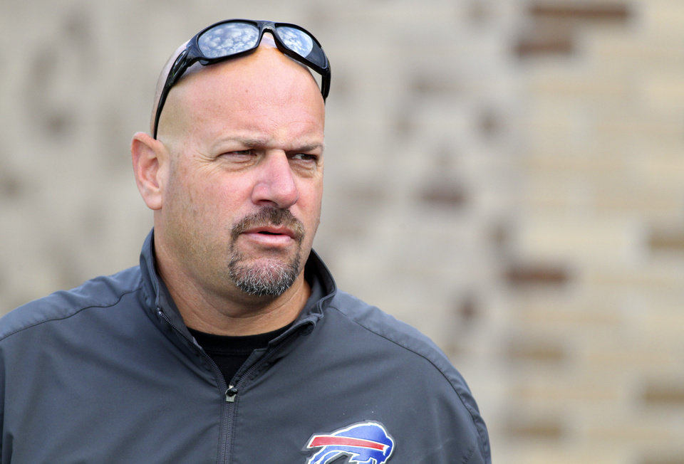 Photo - FILE - In this July 31, 2013, file photo, Buffalo Bills defensive coordinator Mike Pettine walks to the field during NFL football training camp in Pittsford, N.Y. Pettine has interviewed for the Cleveland Browns head coaching position, a person familiar with the Browns' plans told the Associated Press. Pettine interviewed with owner Jimmy Haslam and CEO Joe Banner last week and will have his second meeting on Tuesday night, Jan. 21, 2014, in Mobile, Ala., said the person who spoke on condition of anonymity because the team is not commenting during its search. Pettine is at the Senior Bowl in Mobile with other members of Buffalo's staff. (AP Photo/Bill Wippert, File)