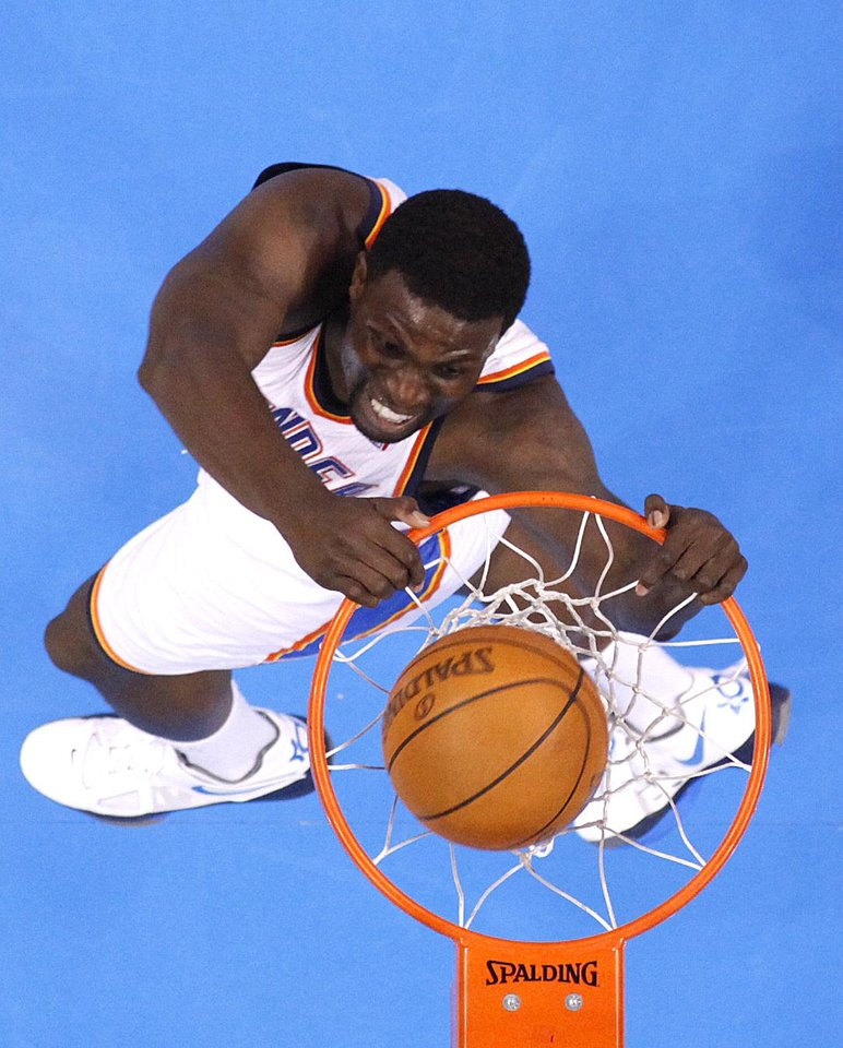 Left: Oklahoma City's Nazr Mohammed dunks the ball during Game 5 of the Thunder-Lakers series. Photo by Sarah Phipps, The Oklahoman