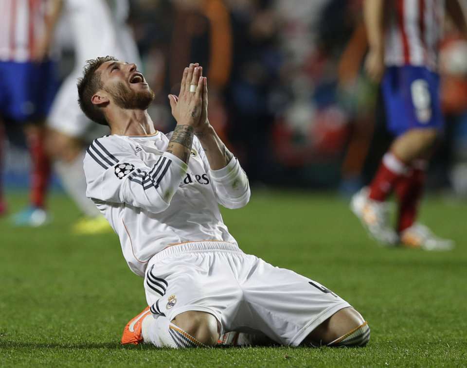 Photo - Real's Sergio Ramos, reacts, during the Champions League final soccer match between Atletico Madrid and Real Madrid, at the Luz stadium, in Lisbon, Portugal, Saturday, May 24, 2014. (AP Photo/Francisco Seco)