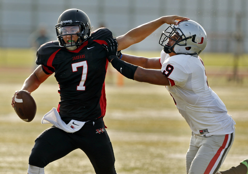 Photo - Tulsa Union's Lorenzo Thomas tries to tackle Westmoore's Bryson Lee at a high school football scrimmage at Harve Collins Field in Norman, Okla., on Thursday, Aug. 21, 2014. Photo by Steve Sisney, The Oklahoman