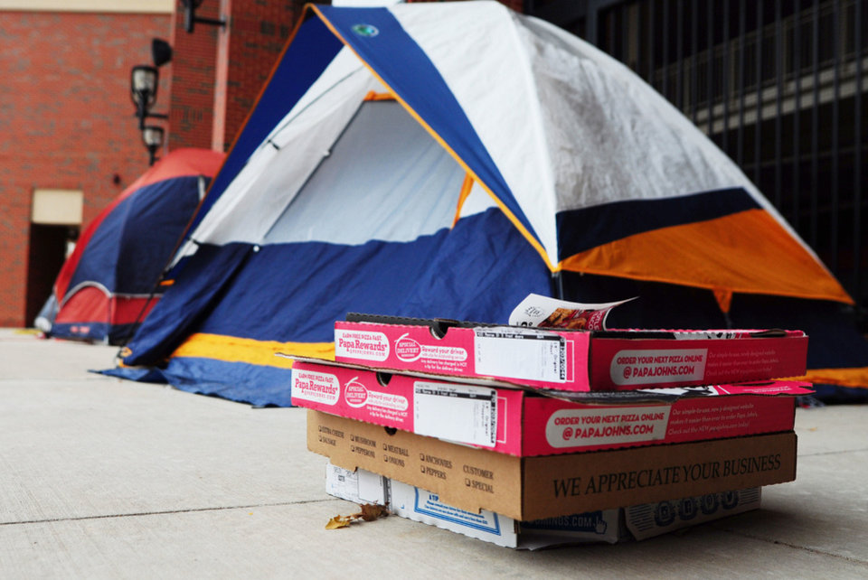 Photo - A freezing student's voice booms from the tent,