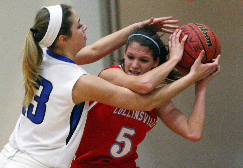 Photo - Collinsville's Shelbie Kirby (5) tries to keep control of the ball while under pressure during the Lady Cardinals' game against Whitney Jones (13) and the Deer Creek Lady Antlers, in Catoosa, on Thursday, March 7, 2013. CORY YOUNG/Tulsa World