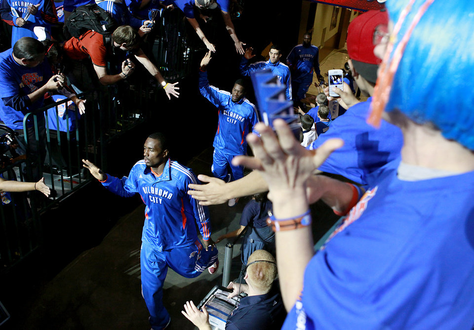 Photo - Fans greet Serge Ibaka and his Thunder teammates as they take the floor prior to game 7 of the NBA basketball Western Conference semifinals between the Memphis Grizzlies and the Oklahoma City Thunder at the OKC Arena in Oklahoma City, Sunday, May 15, 2011. Photo by John Clanton, The Oklahoman