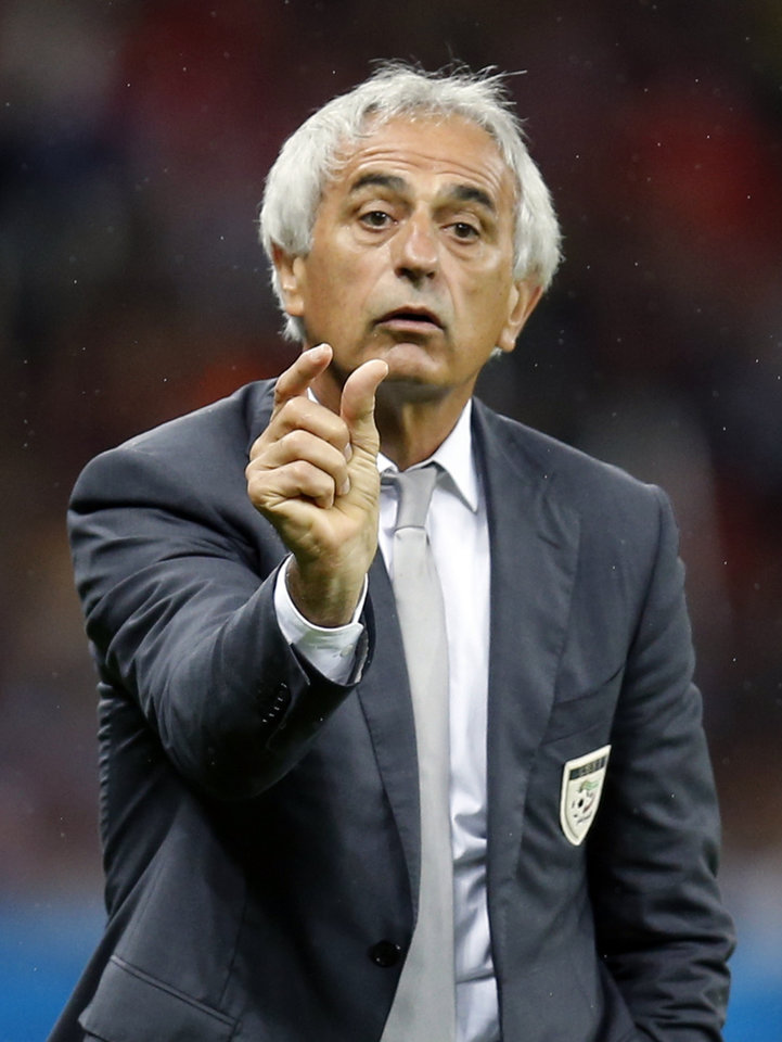 Photo - Algeria's head coach Vahid Halilhodzic gestures during the World Cup round of 16 soccer match between Germany and Algeria at the Estadio Beira-Rio in Porto Alegre, Brazil, Monday, June 30, 2014. (AP Photo/Frank Augstein)