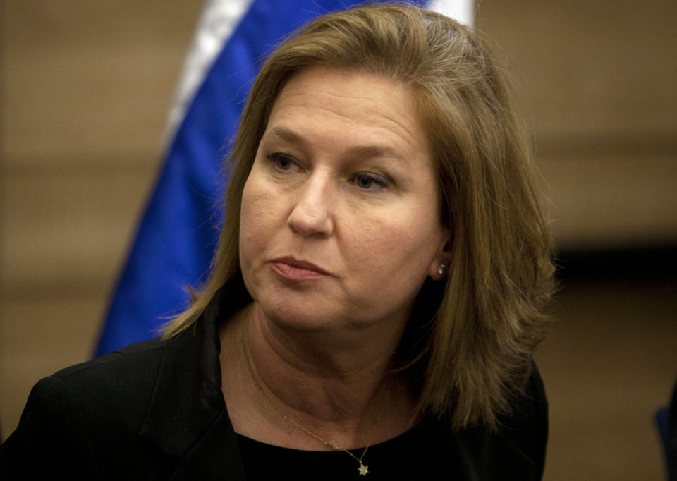 Photo -   FILE - In this Wednesday, Nov. 30, 2011 file photo, head of Israel's parliamentary opposition Tzipi Livni attends a news conference at the Knesset, Israel's parliament, in Jerusalem. Israel's recently ousted opposition leader Livni plans to quit parliament on Tuesday, May 1, 2012, but will remain active in politics, a confidant said. (AP Photo/Sebastian Scheiner, File)