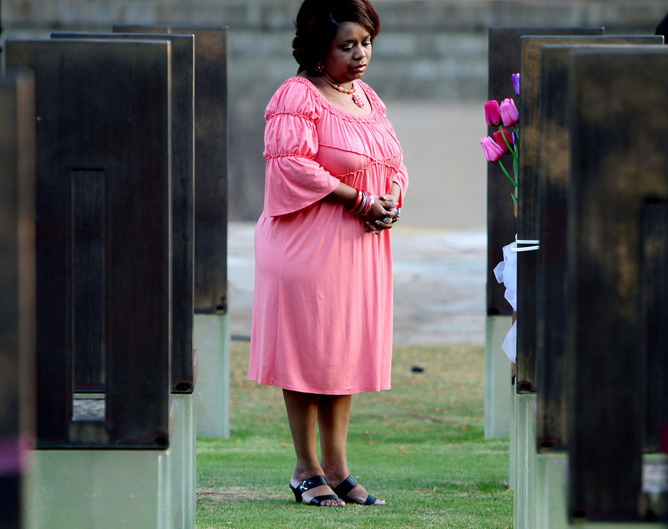 Tracie Harper pauses near the chair dedicated to her sister Christi Jenkins before the Fifteen Years Respect and Resolve ceremony at the Oklahoma City National Memorial & Museum in Oklahoma City, Oklahoma, on April 19, 2010. By John Clanton, The Oklahoman