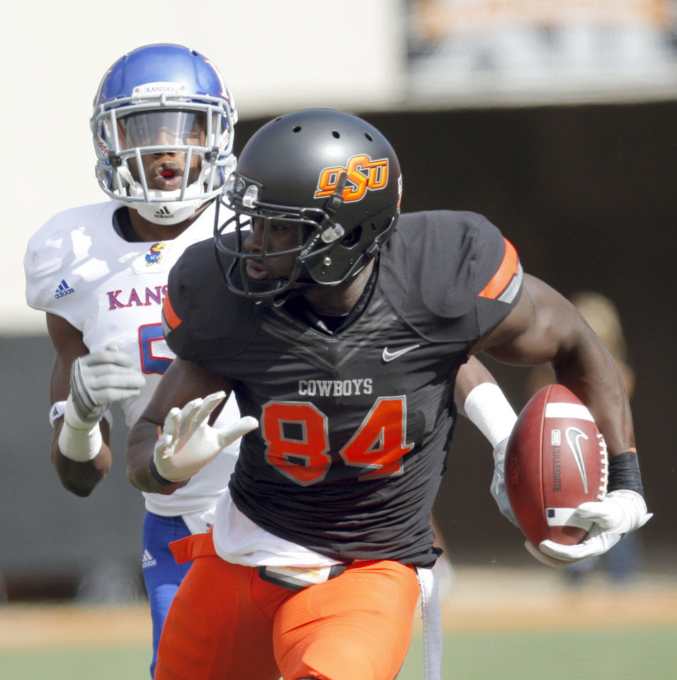 Oklahoma State\'s Hubert Anyiam (84) runs up field as he is chased by Kansas\' Greg Brown (5) during the first half of the college football game between the Oklahoma State University Cowboys (OSU) and the University of Kansas Jayhawks (KU) at Boone Pickens Stadium in Stillwater, Okla., Saturday, Oct. 8, 2011. Photo by Sarah Phipps, The Oklahoman