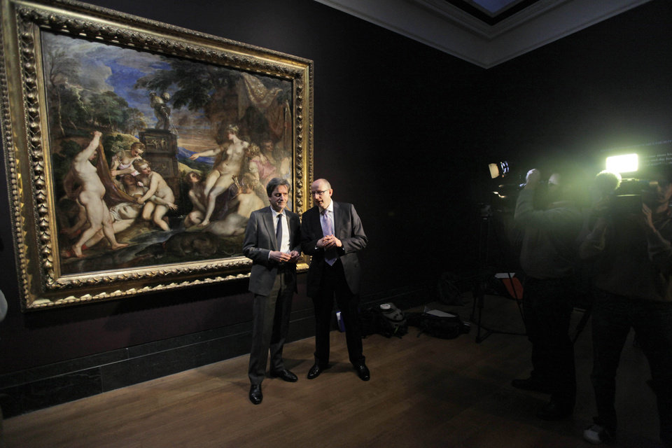 "Britain's National Gallery director Nicholas Penny, left, and National Galleries of Scotland director general John Leighton, talk in front of Titian's ""Diana and Callisto"", during a photo call at Britain's National Gallery in central London, Thursday, March 1, 2012. Britain's National Gallery and the National Gallery of Scotland announced they have raised 45 million British pounds to buy the Renaissance masterpiece that has been in the UK for 200 years and keep it on public display. The purchase means the painting will be reunited with its companion,""Diana and Actaeon,"" which the two galleries bought in 2009. (AP Photo/Lefteris Pitarakis)"