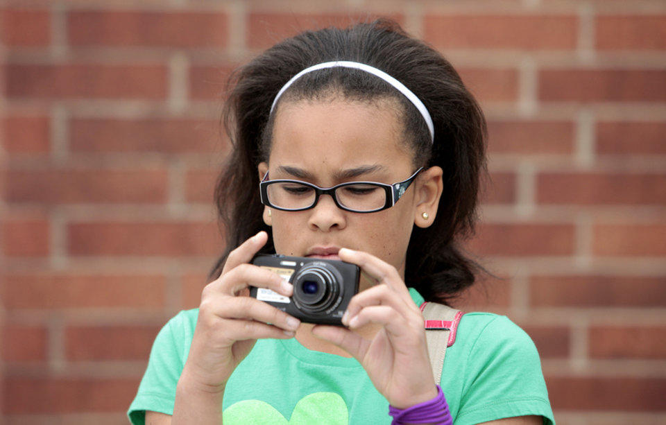 Photo - Junior Sydney Miller, with Troop 822, takes a photo.