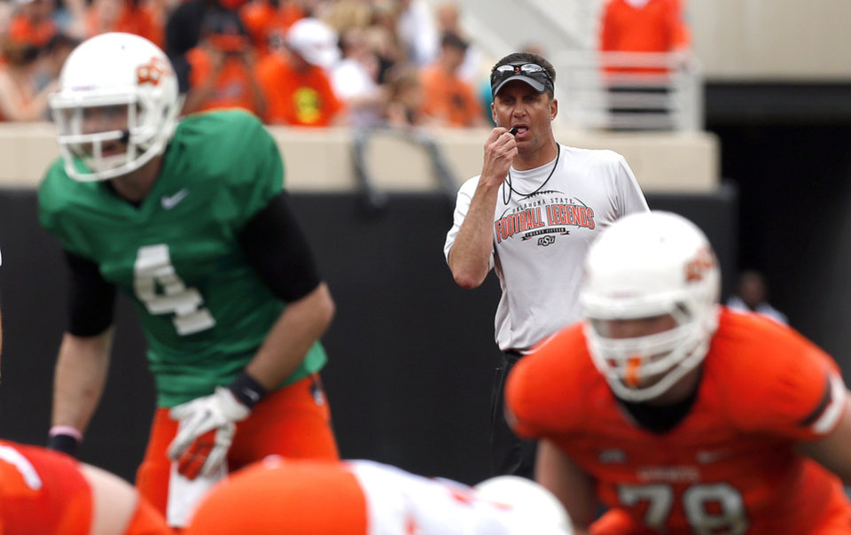Photo - Oklahoma State head coach Mike Gundy coaches during the Oklahoma State University Spring football game at Boone Pickens Stadium in Stillwater, Okla., Saturday, April, 18, 2015. Photo by Sarah Phipps, The Oklahoman