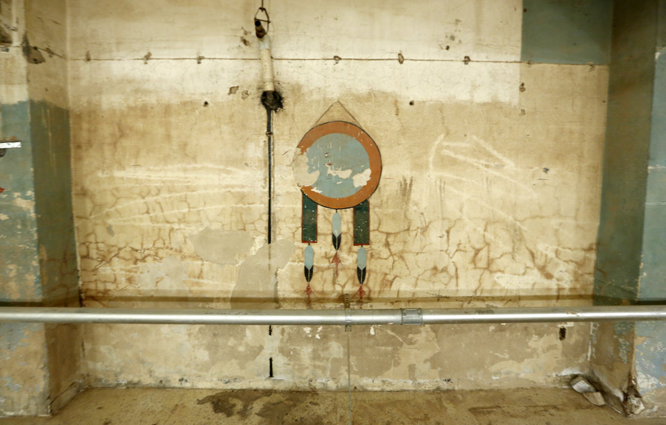Photo - American Indian artwork was discovered during cleanup of the 100 N Walker office building after it was damaged in flooding May 31 in Oklahoma City. Photo By Steve Gooch, The Oklahoman  Steve Gooch