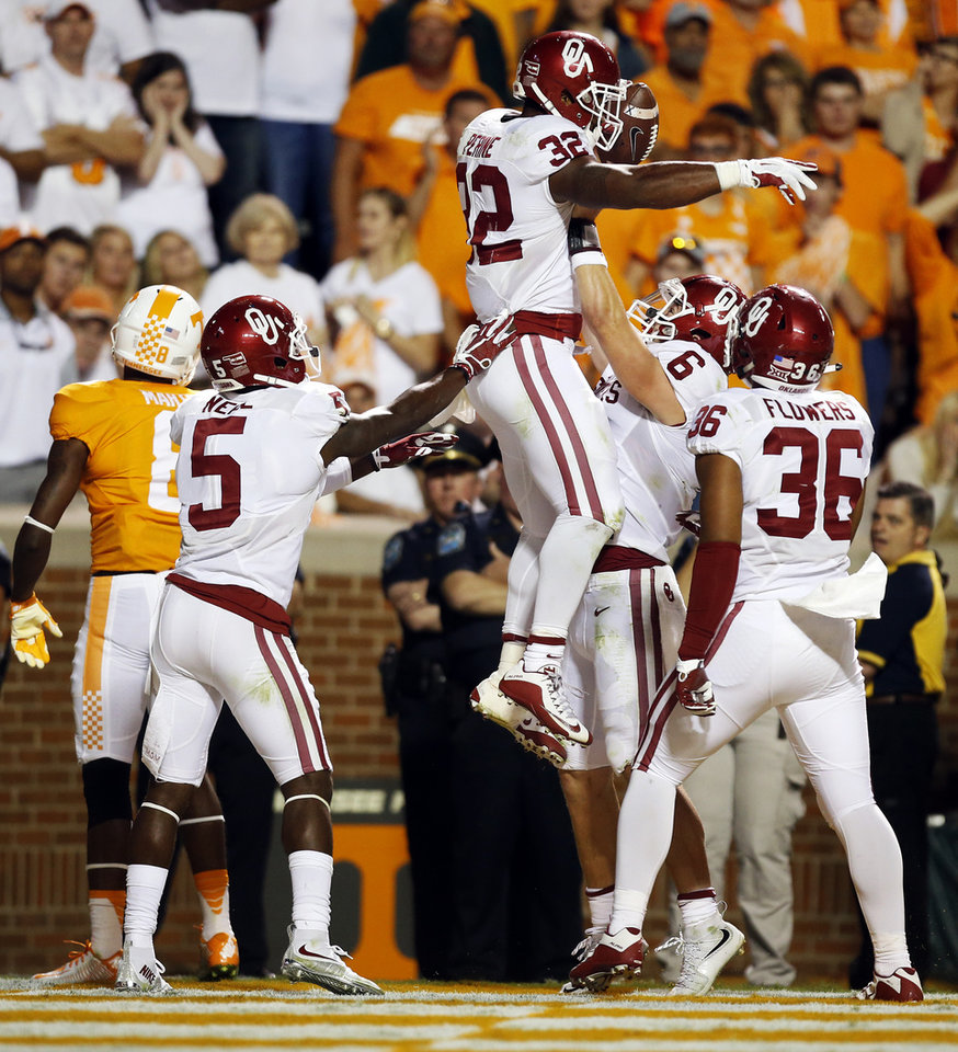 Photo - From left, Oklahoma's Durron Neal (5), Samaje Perine (32), Baker Mayfield (6) and Dimitri Flowers (36) celebrate a touchdown pass from Mayfield to Perine in the fourth quarter of the college football game between the Oklahoma Sooners (OU) and the Tennessee Volunteers at Neyland Stadium in Knoxville, Tennessee, Saturday, Sept. 12, 2015. OU won 31-24 in double overtime. Photo by Nate Billings, The Oklahoman