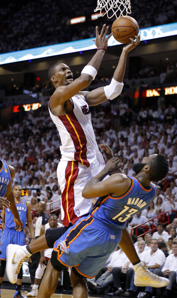 Miami's Chris Bosh (1) is fouled by Oklahoma City's James Harden (13) during Game 5 of the NBA Finals between the Oklahoma City Thunder and the Miami Heat at American Airlines Arena, Thursday, June 21, 2012. Photo by Bryan Terry, The Oklahoman
