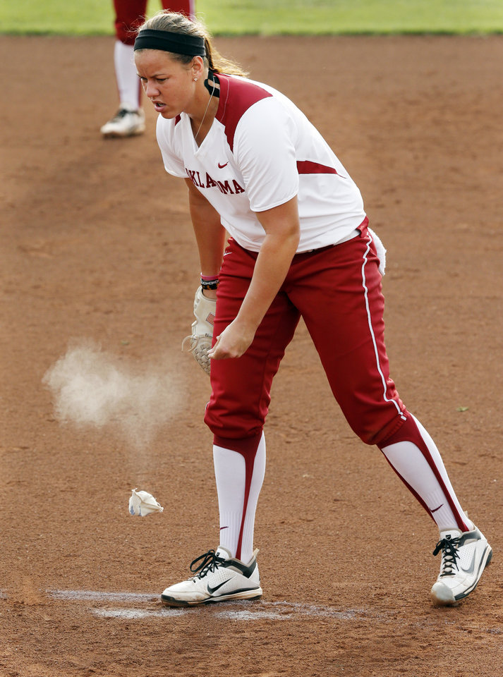 Photo - Sooner pitcher Keilani Ricketts uses a rosin bag as she pitches during the NCAA Super Regional softball game as the University of Oklahoma (OU) Sooners defeats Texas A&M 10-2 at Marita Hines Field on Friday, May 24, 2013 in Norman, Okla. Photo by Steve Sisney, The Oklahoman